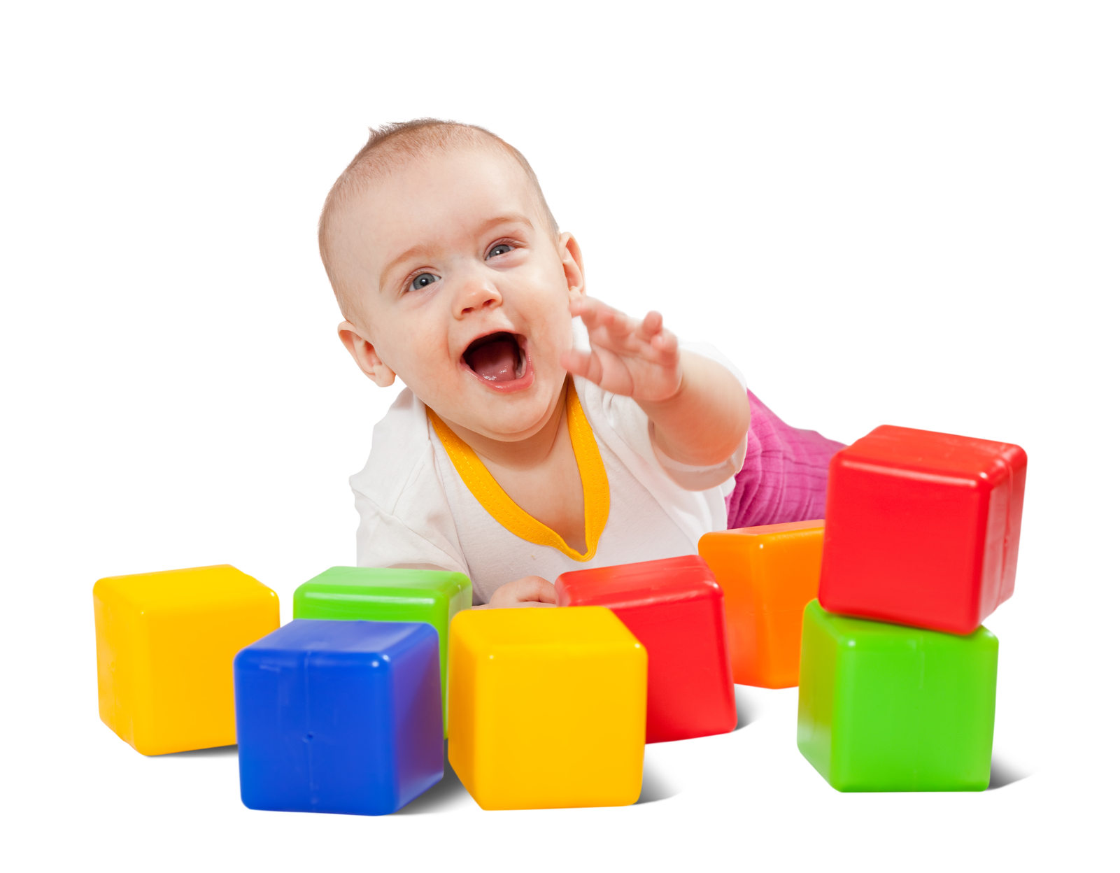 Happy baby plays  with toy blocks over white background